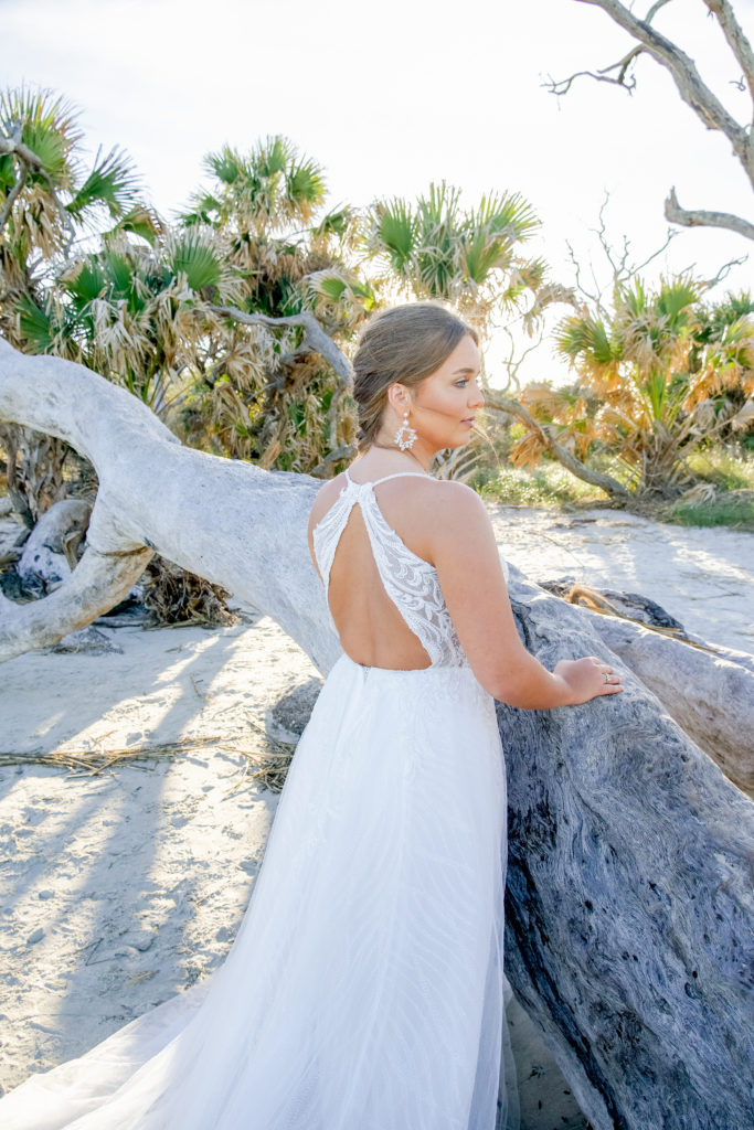 back of beaded lace and tulle aline wedding dress with open back at driftwood beach