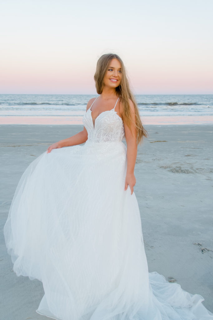 beaded lace and tulle aline wedding dress on beach at sunrise
