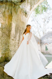 classic wedding dress in ivory with tulle cape