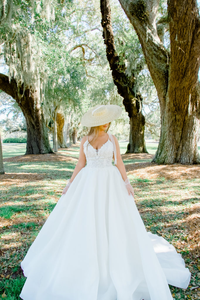 lace and organza wedding dress with straw hat and lace gloves
